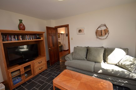 Wellfleet Cape Cod vacation rental - Living room with flat screen TV off dining area