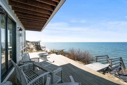 Eastham Cape Cod vacation rental - Back deck with hanging chairs to relax on