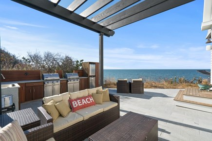Eastham Cape Cod vacation rental - Patio with outdoor living room and pergola