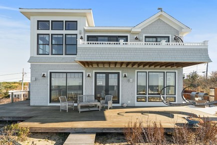 Eastham Cape Cod vacation rental - Back of the house showing large deck for entertaining