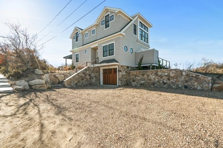 Eastham Cape Cod vacation rental - Front of the house with stone walls and garage