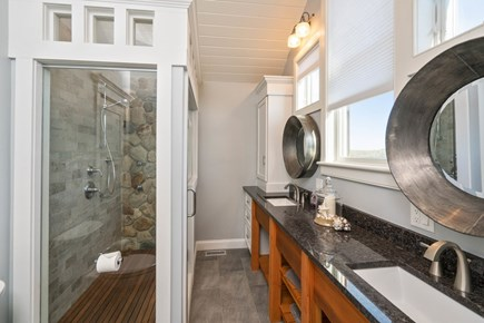 Eastham Cape Cod vacation rental - Master bathroom with stone wall shower and body sprays