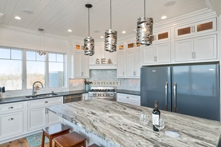 Eastham Cape Cod vacation rental - Custom kitchen with large granite island