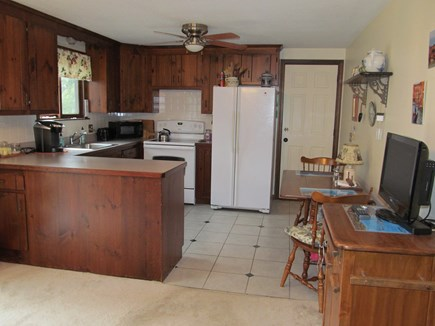 East Dennis Cape Cod vacation rental - Fully equipped kitchen w/ electric stove, microwave, keurig & TV.