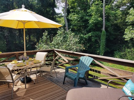 East Dennis Cape Cod vacation rental - Deck complete with a table & four chairs, gas grill and chaise.