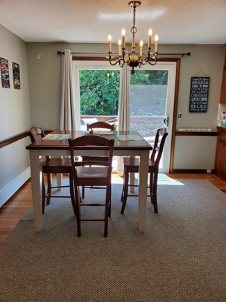 East Dennis Cape Cod vacation rental - Dining room opens to quiet 10x12 deck.