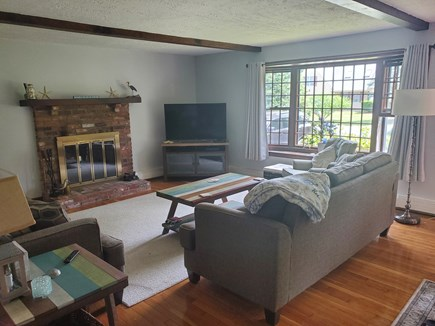 East Dennis Cape Cod vacation rental - Large cozy family room with fire place, smart tv and wifi