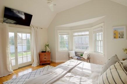 Popponesset, Mashpee Cape Cod vacation rental - 1st floor Master Bedroom with door to back patio