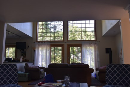 Chatham Cape Cod vacation rental - Family room with cathedral windows facing back of house.