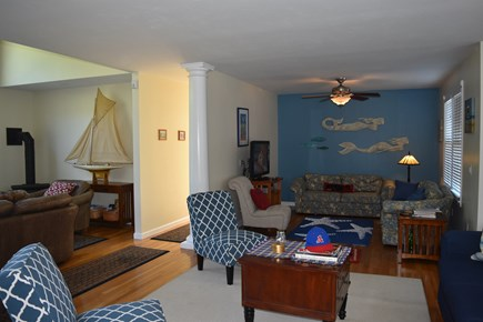 Chatham Cape Cod vacation rental - Mermaids are in TV area.  Living room first floor.
