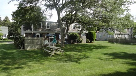 Falmouth Cape Cod vacation rental - Back yard with picnic table and outdoor shower