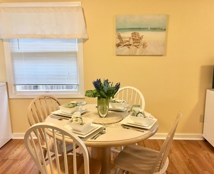 Falmouth Cape Cod vacation rental - Dining Room (full-size washer/dryer area to the left)