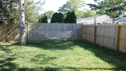 Falmouth Cape Cod vacation rental - A peaceful corner of the backyard to lounge in the hammock.