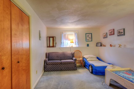 East Sandwich Cape Cod vacation rental - Bedroom with Toddler car bed & Full size sofa bed on lower level