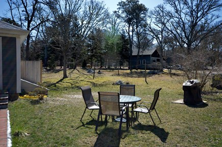 Brewster Cape Cod vacation rental - Enjoy meals outside Table has umbrella for 4 and gas grill.