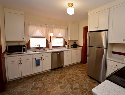 Brewster Cape Cod vacation rental - Full kitchen with door to backyard. Laundry room attached.
