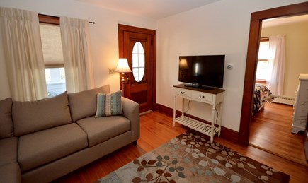Brewster Cape Cod vacation rental - Comfy living area with flat screen TV, access to enclosed front p