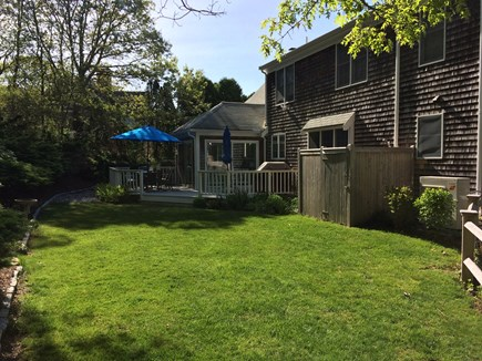 East Dennis Cape Cod vacation rental - Backyard -Very private and quiet..outdoor shower and green lawn!