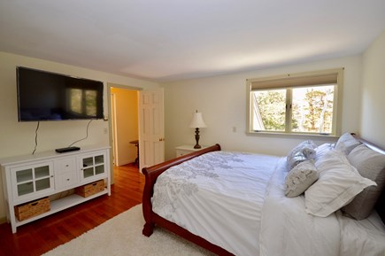 Brewster Cape Cod vacation rental - Upper level master bedroom with king bed, large flat screen TV an