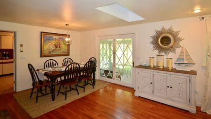 Brewster Cape Cod vacation rental - Dining area opens into kitchen, sunroom and living area