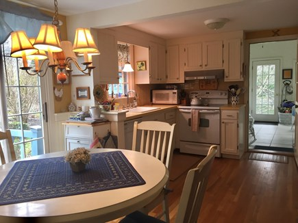 Brewster Cape Cod vacation rental - Look from dining back toward kitchen and sun room