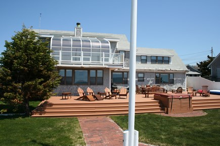 Oceanfront Residential Hyannis Cape Cod vacation rental - Backyard View of Expansive Outdoor Living Area and Jacuzzi!