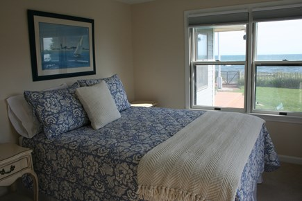 Oceanfront Residential Hyannis Cape Cod vacation rental - First Floor Queen with Stretches of Green Grass and Blue Ocean