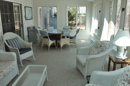 Eastham Cape Cod vacation rental - Inviting sun porch with dining table, ample seating and cable TV.