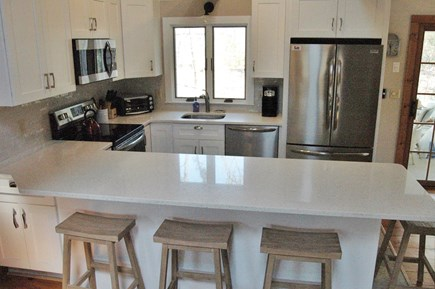 Eastham Cape Cod vacation rental - Stainless steel appliances and quartz counter top.