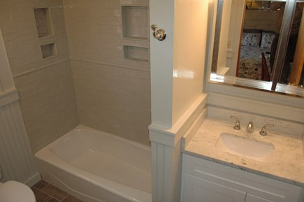 Eastham Cape Cod vacation rental - Fully renovated master bath with tub and shower head.
