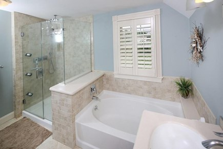 Plymouth MA vacation rental - Master Bath-Rain Shower, Tub, toilet, double vanity, washer/dryer
