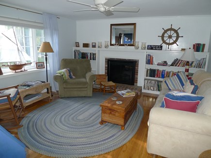 Brewster Cape Cod vacation rental - Wonderful living room with fireplace and library