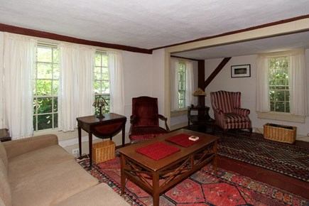 Harwich -  Cape Cod vacation rental - Living room with charming fireplace.