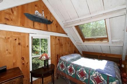 Harwich -  Cape Cod vacation rental - 2nd floor bedroom with queen bed and en suite full bath.