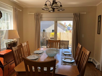Falmouth Heights Cape Cod vacation rental - Cheerful dining room with French doors to deck; seats 6 to 8.