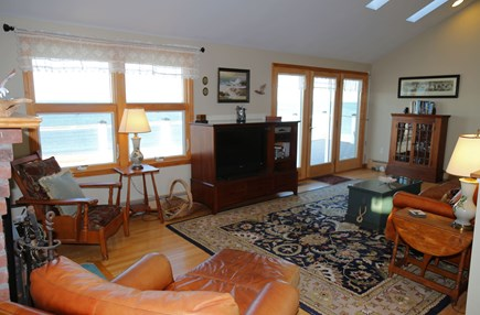 East Sandwich Cape Cod vacation rental - Living Room with access to deck and ocean views.