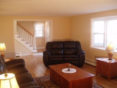 South Yarmouth Cape Cod vacation rental - Living room view showing staircase to second floor.