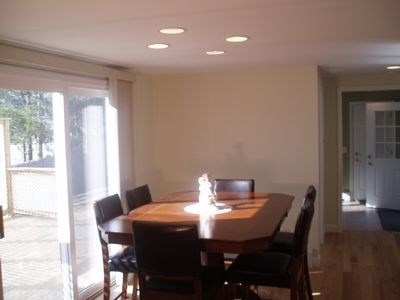 South Yarmouth Cape Cod vacation rental - Dining area with slider to deck and outside shower.