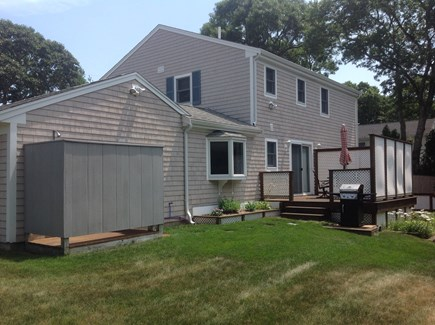 South Yarmouth Cape Cod vacation rental - Back view of house showing deck and enclosed outside shower