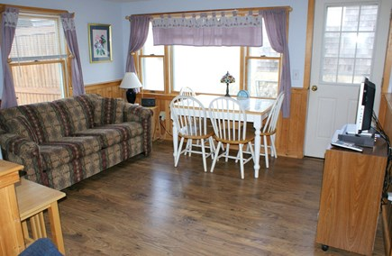 East Sandwich Cape Cod vacation rental - Open Living/Dining area with sleep sofa and access to deck.