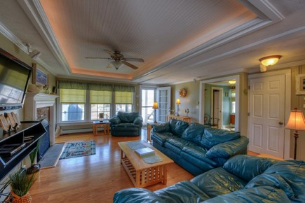 East Sandwich Cape Cod vacation rental - Living Room with gas fireplace opens to lower level deck.