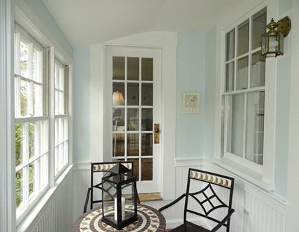 harwich Cape Cod vacation rental - Front sun porch with seating area - great for morning coffee!
