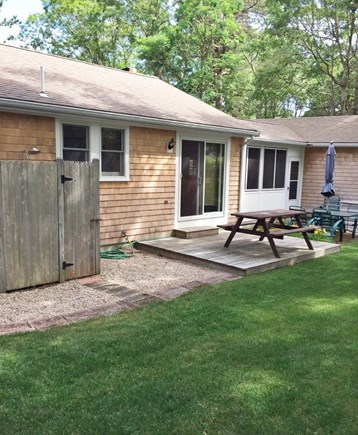 South Dennis Cape Cod vacation rental - Back yard with deck, BBQ grill, and outdoor shower