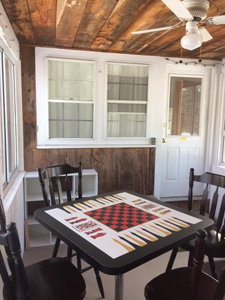 South Dennis Cape Cod vacation rental - Relax and unwind on the porch. Great for family game nights.