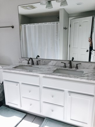 South Dennis Cape Cod vacation rental - Bathroom with double sink, bath tub/shower combo