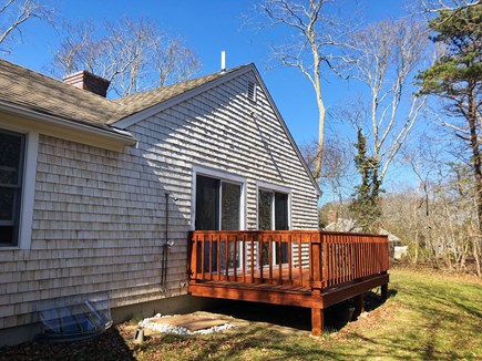 South Dennis Cape Cod vacation rental - Back of house, porch with sliders opening from bedroom #1 and #2