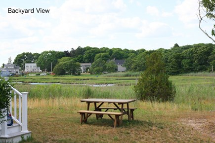 Bourne, Pocasset Cape Cod vacation rental - Back yard picnic area with a marsh view