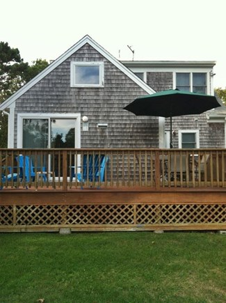 South Yarmouth Cape Cod vacation rental - Large Back Deck  with plenty of seating and outdoor grill.