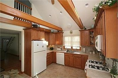 South Yarmouth Cape Cod vacation rental - Eat in Kitchen with high ceilings and slider to back deck.