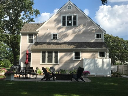West Yarmouth Cape Cod vacation rental - Back patio: gas fire pit, gas grill & enclosed outdoor shower.